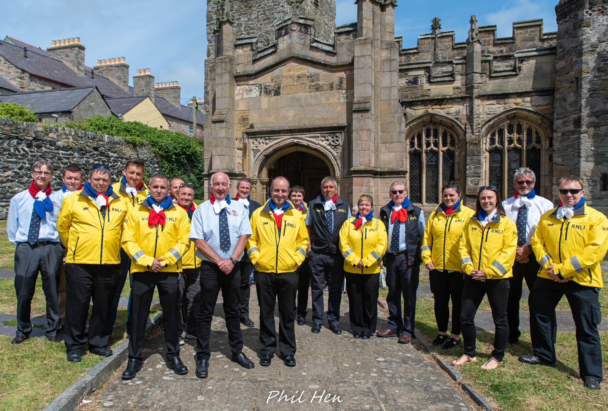 Group of RNLI lifeboat men in front of a church