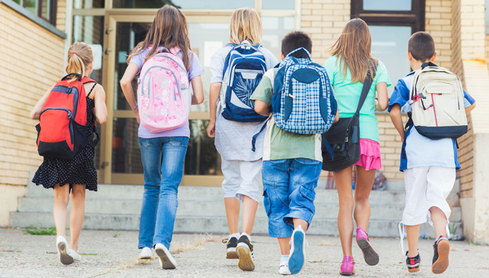 Group of kids walking into school together