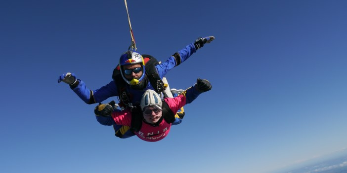 Members of Team RNIB take part in a tandem skydive.