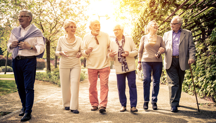 Elderly people taking a walk together on a sunny day