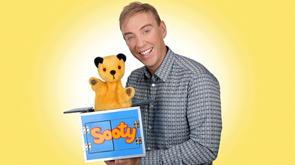 Richard and Sooty on a yellow background