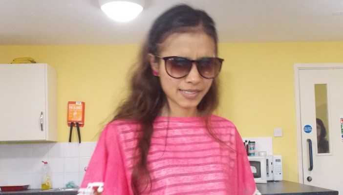 Photo of Sristi standing up wearing a pink top