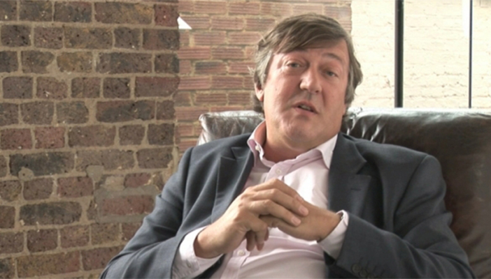 Stephen Fry sat on chair