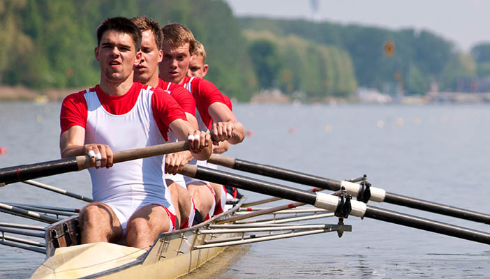 People rowing down a river
