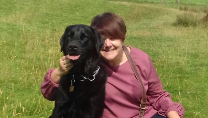 Photo of Sue with her guide dog