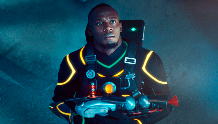 Olympic sprint champion Usain Bolt dressed as superhero Super Bolt, holding a blaster