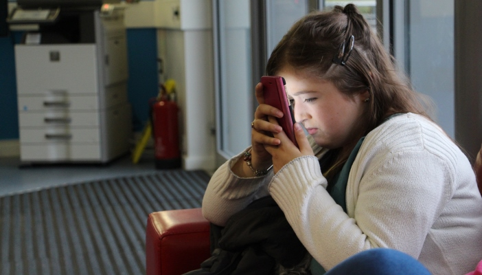 Teenager looking closely at phone