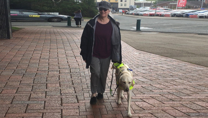 Image shows Terri Balon with guide dog Daisy