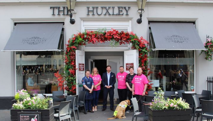 Staff from The Huxley and RNIB Volunteers outside the pub
