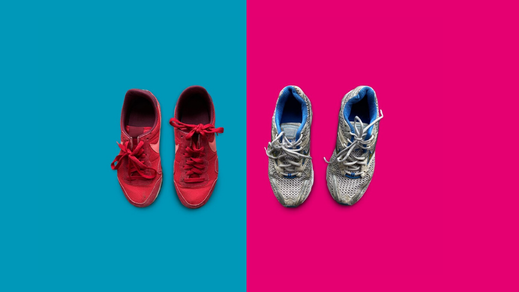 Two pairs of worn trainers side-by-side