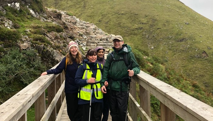 Team RNIB Trekkers take a break on their way up Ben Nevis