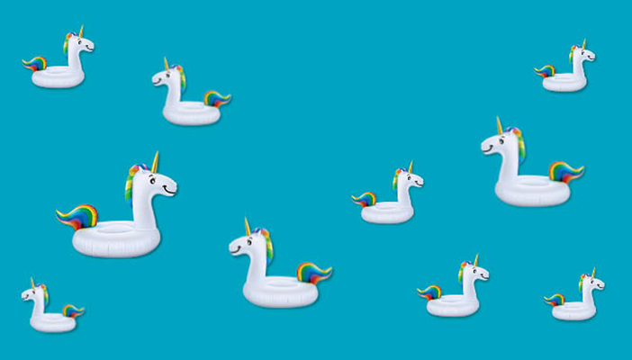 Small unicorns against a blue background