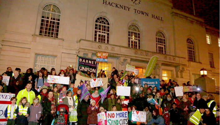 Parents and children gather with banners outside Hackney Town Hall