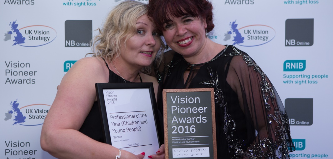 Photo of last year's Professional of the Year (Children and Young People) award winner holding her certificate with her colleague holding her award