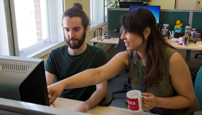 Lorenzo and his intern manager, Krista looking at a computer screen
