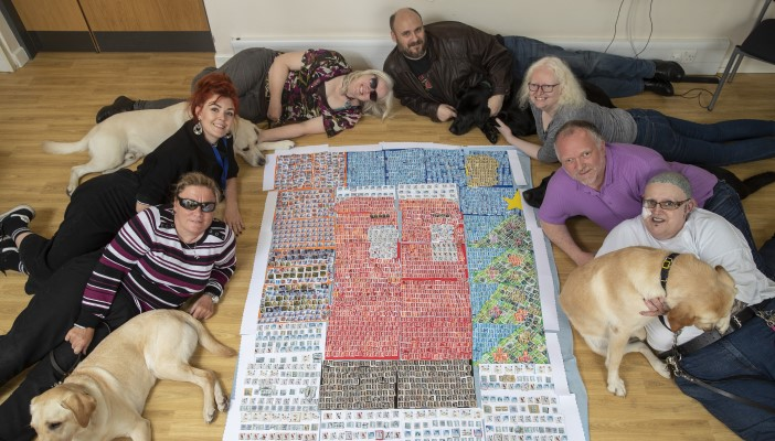 Blind and partially sighted volunteers with Christmas collage