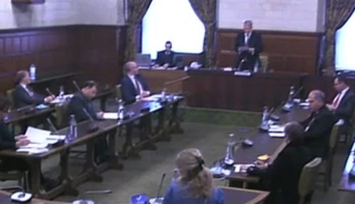 MPs sitting at tables in Westminster Hall