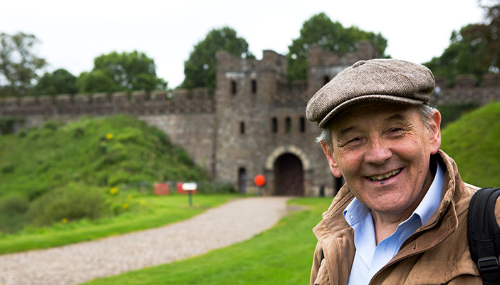 Man outside a welsh castle