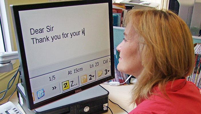Photo of lady at a desk using ZoomText