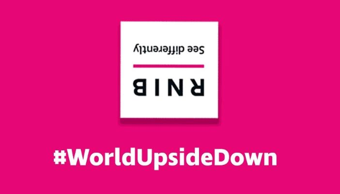 RNIB's logo upside down on a pink background with #WorldUpsideDown underneath