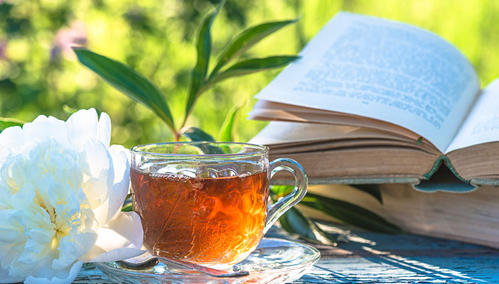 An open book and a cup of tea