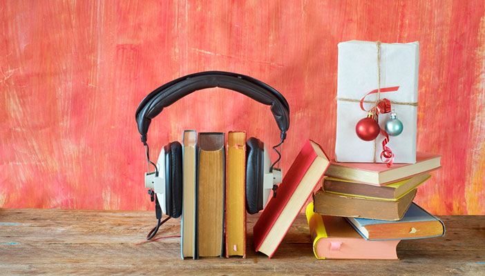 Headphones on books and Christmas present with baubles
