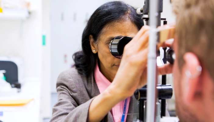An optometrist conducing an eye examination