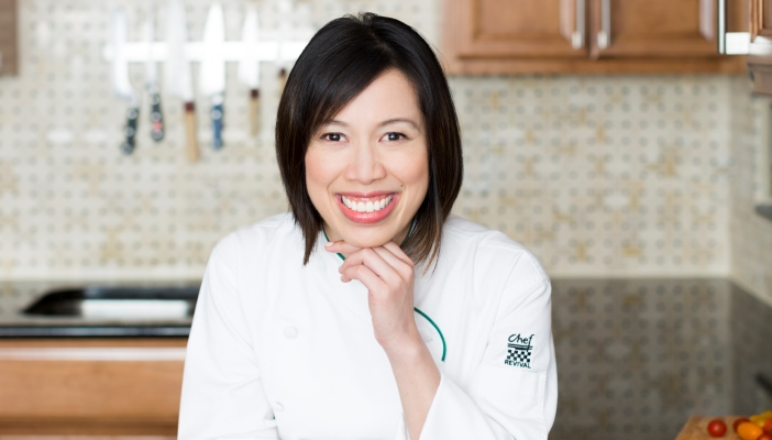 Photo of Christine Ha in a kitchen