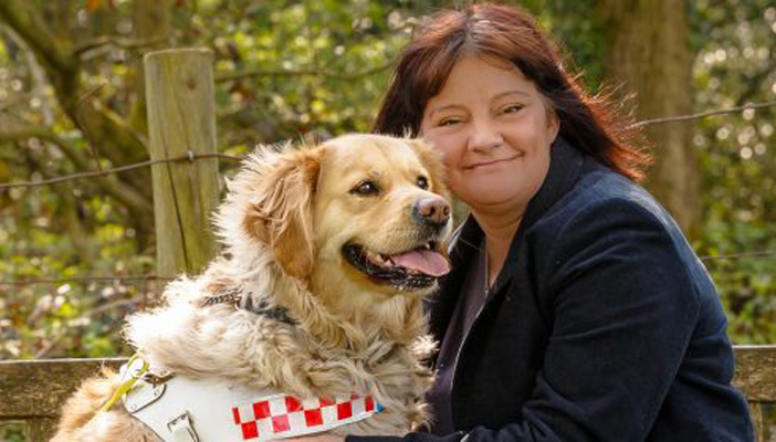 dianne and her guide dog outside