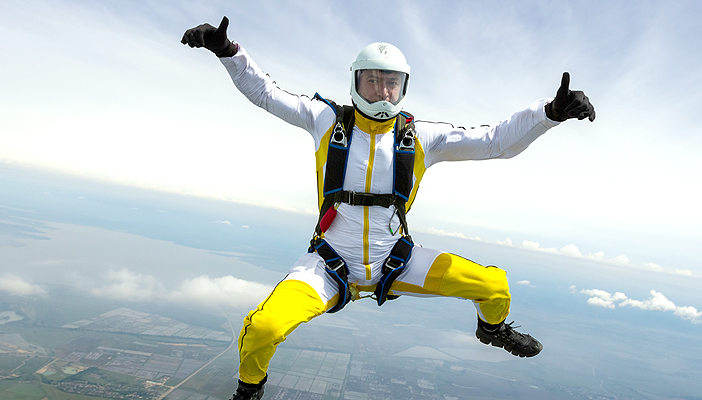 Image shows a man mid fall with his protective gear and his thumbs up
