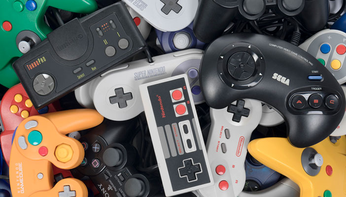 A pile of vintage games controllers