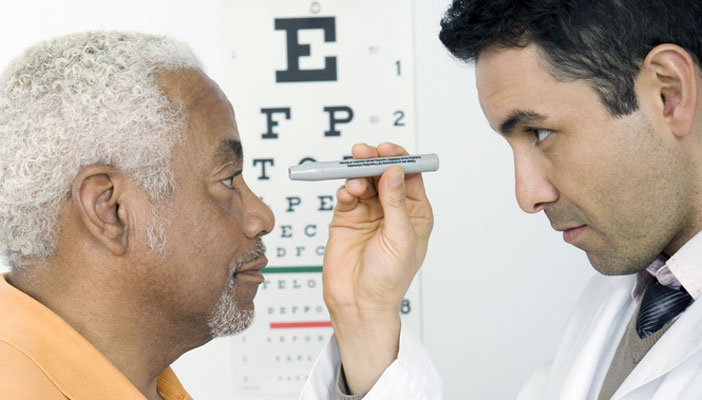 Patient getting his eyes tested by a professional