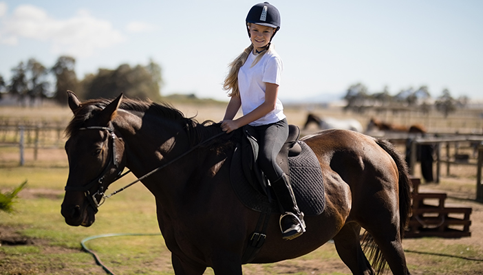 Photo of a young person on a horse