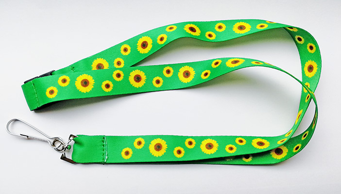 Hidden disabilities lanyard - a green lanyard with a pattern of sunflowers