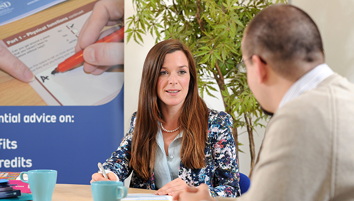 One of our Welfare Rights Officers, Laura, chatting to a client.