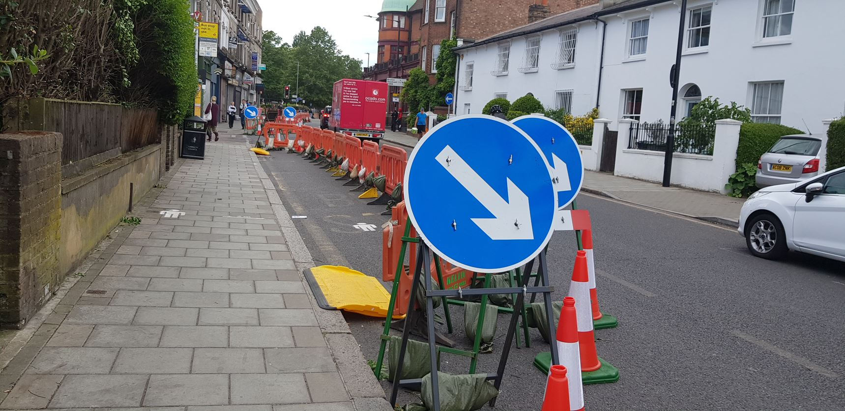 Image of a pavement that has been extended into the road with cones separating the two areas.