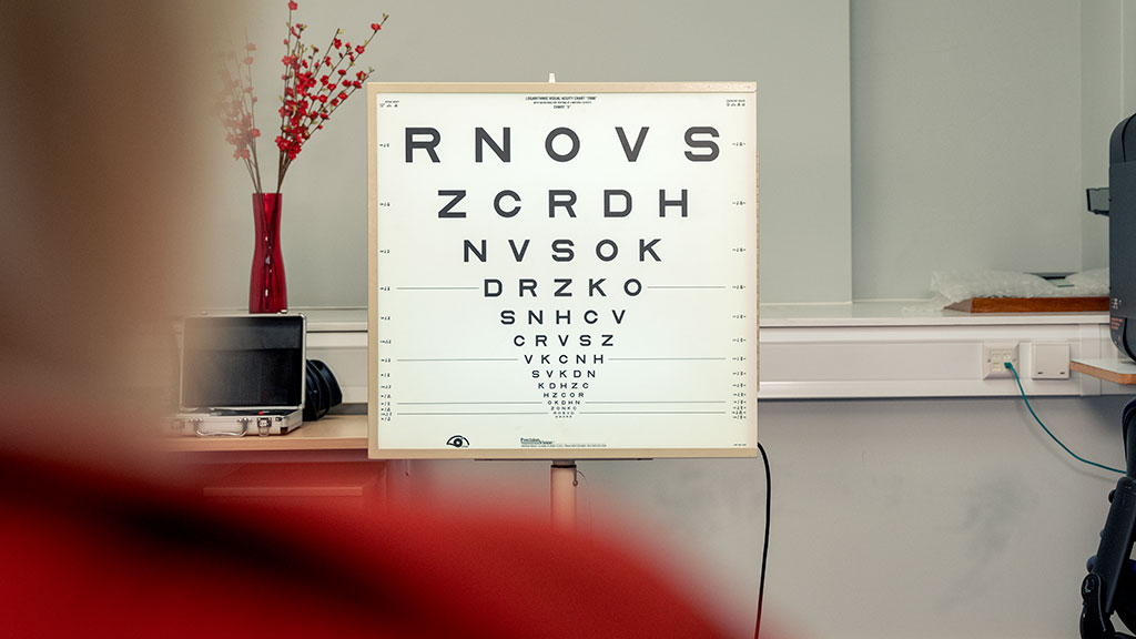 Inside an optometrist's office with an eye test chart in focus