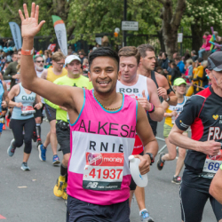 Alkesh waves as he runs the London Marathon for RNIB