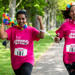Two Double Dash runners, smiling and wearing flowers