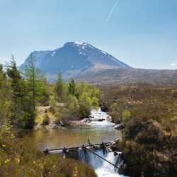 River running through the Scottish Highlands with Ben Nevis in the background