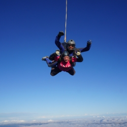 Zoe smiling as she free falls during her tandem skydive