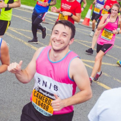 Member of Team RNIB running in a marathon