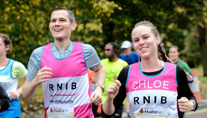 Chloe and Mike running past the RNIB cheer point