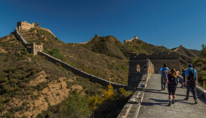 Image shows people walking along the Great Wall of China