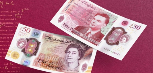 Two new £50 notes, one showing the side with the Queen's head on it, the other showing the side with Alan Turing on the note