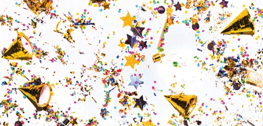 Image shows gold confetti and party hats