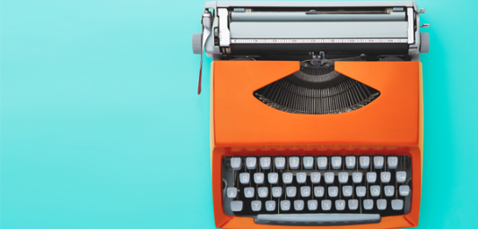 Orange typewriter on blue background