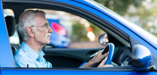 Man driving a blue car