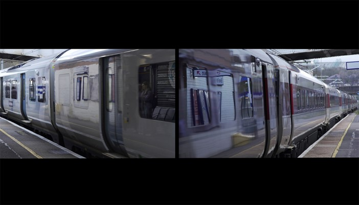 An image of two trains running along two platforms.  One of the platforms has tactile paving and the other does not.